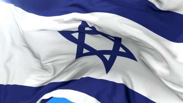 Israeli flag waving at wind with blue sky in slow, loop video
