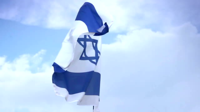 Israeli national flag waving on flagpole. Israel, Palestine video