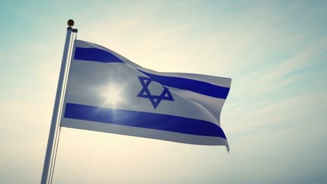 vídeos de stock, filmes e b-roll de a bandeira de ondulação israelita que voa descreve o estado de israel insignia-4k 30fps vídeo filmagens - insígnia