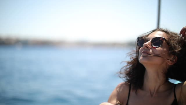 It was a long journey Beautiful young woman enjoying the view of the Corfu town, from a boat, Corfu island, Greece real life stock videos & royalty-free footage