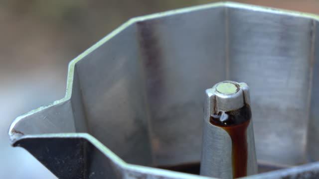Italian coffee sprinkling out of moka coffee-maker video