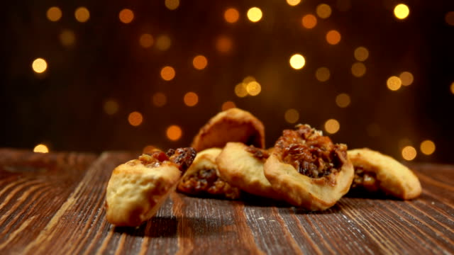 Italian Fig Cookies Cucidati falls on a wooden surface