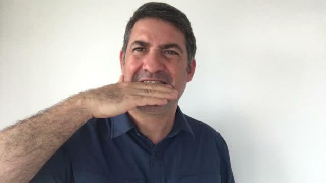 Italian man demonstrate Damn you sign of Italian hand gestures video