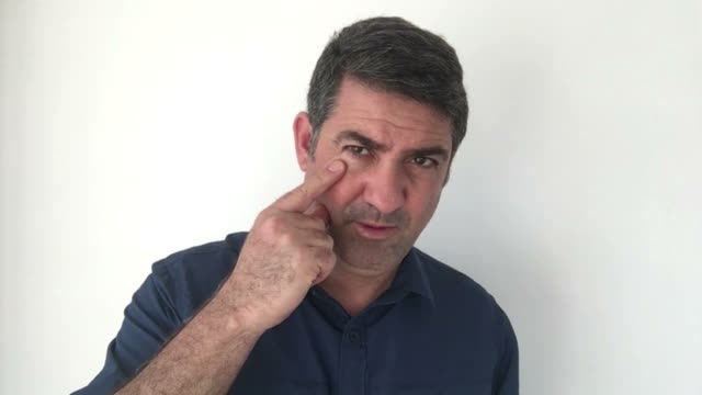 Italian man demonstrate I am watching you sign of Italian hand gestures video