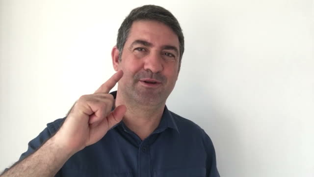 Italian man demonstrate You made the right decision sign of Italian hand gestures video