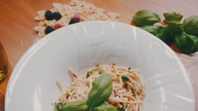 Italian pasta on table in restaurant. Italian food, meal, lunch, cuisine, plate. Italian pasta on table in restaurant. Italian food, meal, lunch, cuisine, plate. macaroni stock videos & royalty-free footage