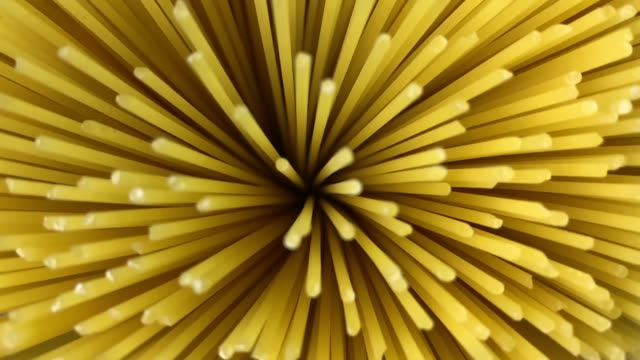 Italian pasta, spaghetti, falling in slow motion Italian pasta, spaghetti, falling in slow motion uncooked pasta stock videos & royalty-free footage
