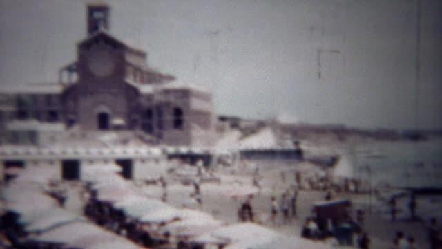 1954: Italian riviera beach church recreational play area. video