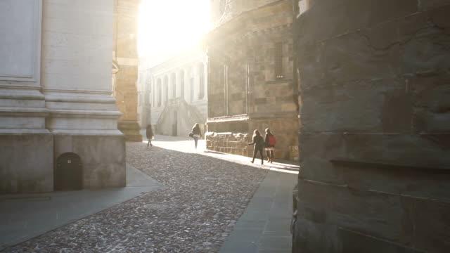 Italian street and people walking in slow motion video