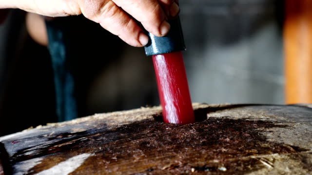 Italian Traditions- putting the homemade wine in the barrel- South of Italy video