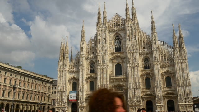 italy day time milan city duomo cathedral square walking center panorama 4k video