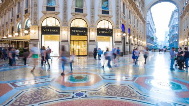 italy evening illuminated milan city famous galleria center panorama 4k timelapse - milan video stock e b–roll