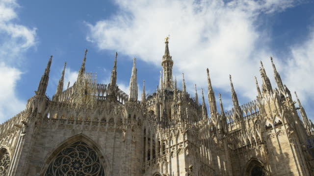 italy milan city sunny day duomo cathedral roof top decoration sky panorama 4k - cathedrals stock videos & royalty-free footage