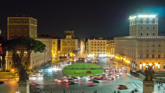 italy night illumination rome city square piazza venezia traffic circle panorama 4k time lapse video