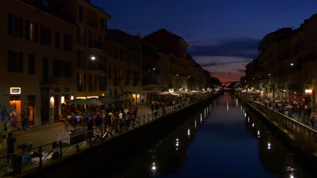 italy night sunset milan city famous navigli lombardi canal reflection bay panorama 4k - итальянская культура стоковые видео и кадры b-roll