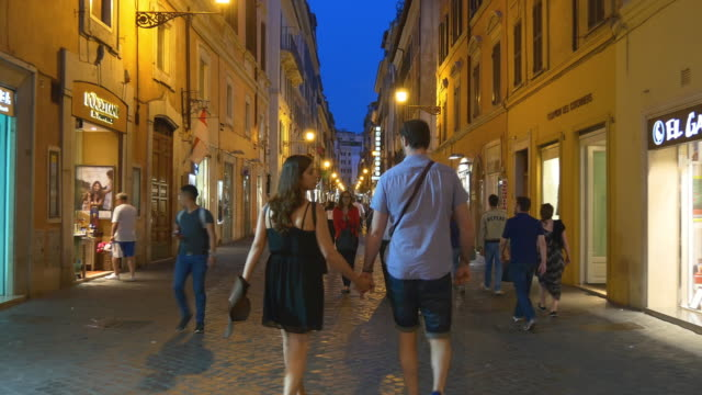 italy rome city night illumination walking street panorama 4k - rome road central view video stock e b–roll