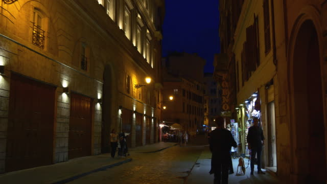 italy rome city night light street walking panorama 4k - rome road central view video stock e b–roll
