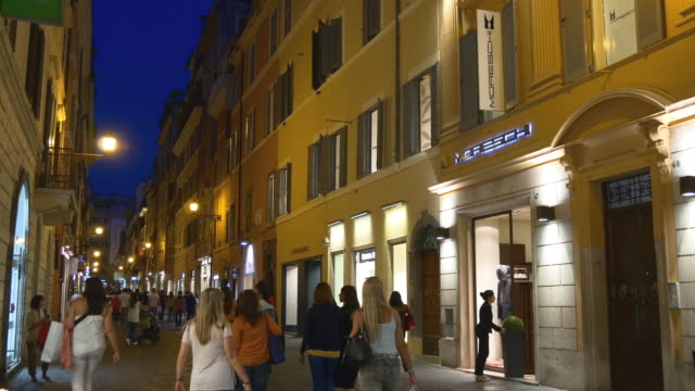 italy rome city night light walking street famous tourist panorama 4k - rome road central view video stock e b–roll