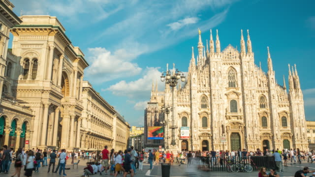 italy sunny day milan famous duomo cathedral front crowded panorama 4k time lapse - milan video stock e b–roll