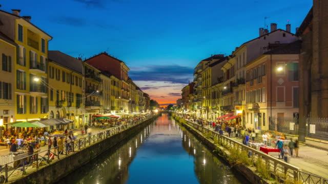 italy sunset milan ripa di porta ticinese grande canal cafe panorama 4k time lapse - milan video stock e b–roll