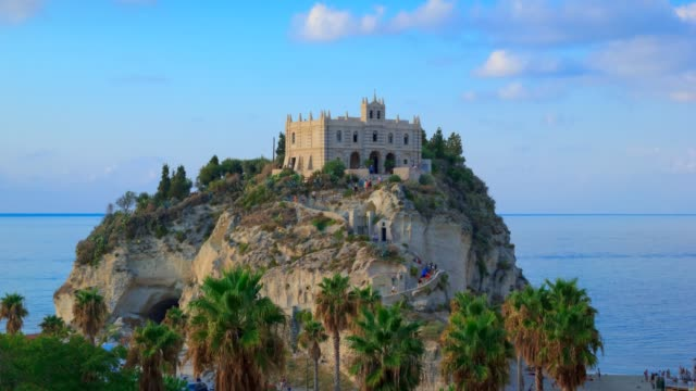 italy, tropea timelapse with view on sea and church on mountain rock. - tropea video stock e b–roll