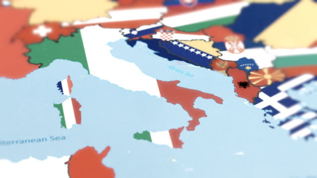 italy with national flag on world map - cartina italia video stock e b–roll