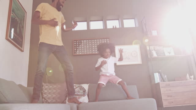 It's a boys day of fun! 4k video footage of a happy father and his little son playing together in their living room at home living room stock videos & royalty-free footage