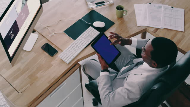 It's more convenient to organise everything digitally 4k video footage of a businessman using a digital tablet in an office homepage stock videos & royalty-free footage
