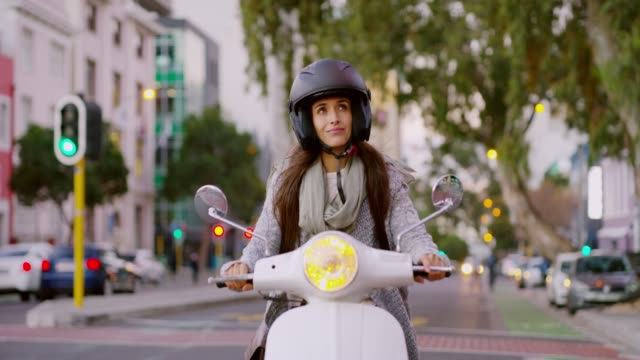 It's one of the most stylish rides you will find 4k video footage of a woman riding her scooter through the city crash helmet stock videos & royalty-free footage