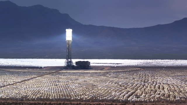 Ivanpah CSP Plant, California - Drone Shot Drone shot of the Ivanpah Solar Facility, a concentrated solar thermal plant in the Mojave Desert, which is made up of three solar power towers surrounded by 173,500 mirrors that direct sunlight towards boilers of molten salt. power supply stock videos & royalty-free footage