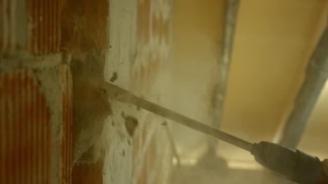 SLO MO Jackhammer chipping away a wall