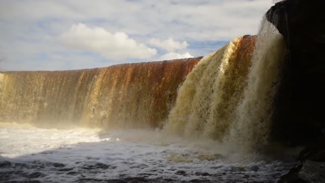 Jagala waterfall at spring, Estonia Jagala waterfall at spring, Estonia. Full of water estonia stock videos & royalty-free footage