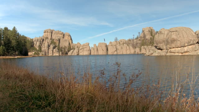 Jagged rock formations rising from Sylvan Lake in Black Hills, Custer State Park
