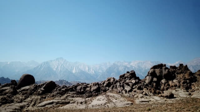 Jagged Rock Ridge Under Distant Snowcapped Mountains video