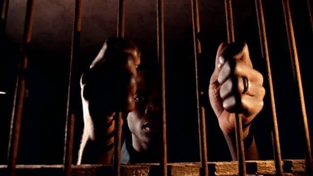 jail, human rights, imprisonment. sad Black african man in the jail jail, human rights, imprisonment. sad Black african man in the jail prison bars stock videos & royalty-free footage