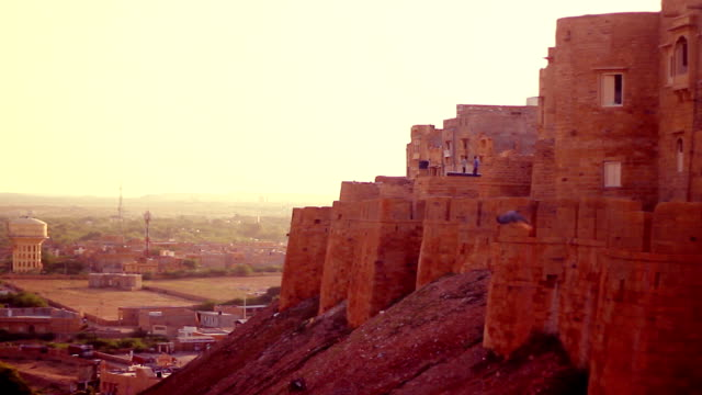 Jaisalmer Fort's sandstone wall at sunset. video