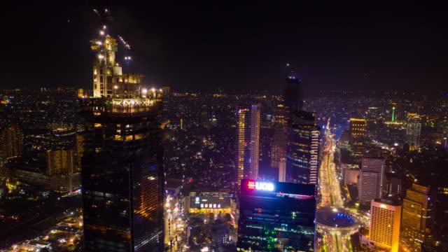 jakarta city night illumination jakarta city main traffic street fountain circle aerial panorama 4k indonesia - vídeo