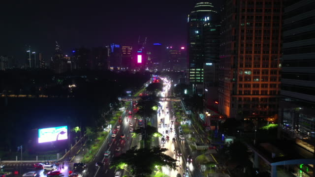 jakarta city night time illumination downtown busy traffic street avenue aerial panorama 4k indonesia jakarta city night time illumination downtown busy traffic street avenue aerial panorama 4k indonesia jakarta stock videos & royalty-free footage