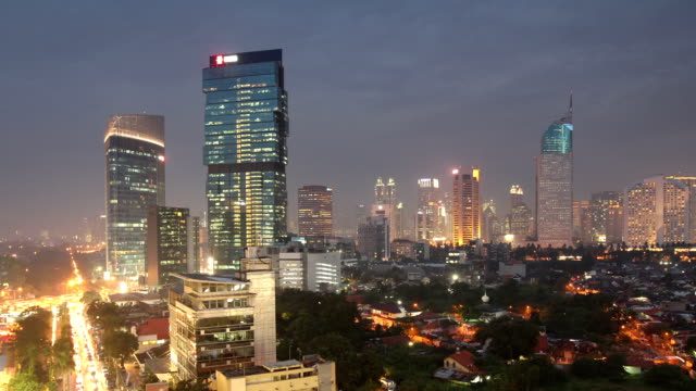 Jakarta Indonesia Time Lapse Time lapse pan of Jakarta during night fall. jakarta stock videos & royalty-free footage