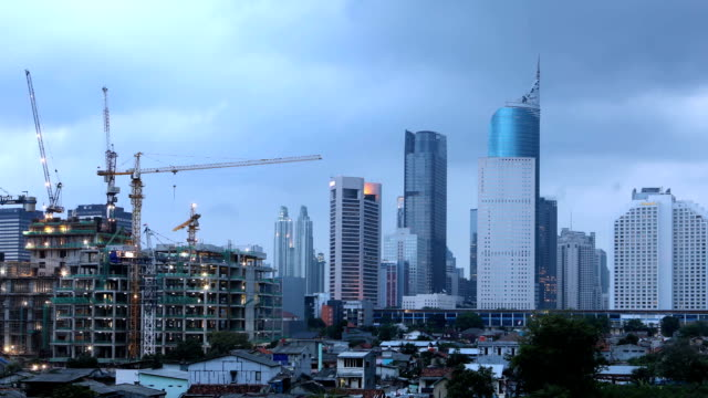 Jakarta skyline timelapse Day to night time lapse of jakart skyline with modern buildings in a cloudy day jakarta stock videos & royalty-free footage
