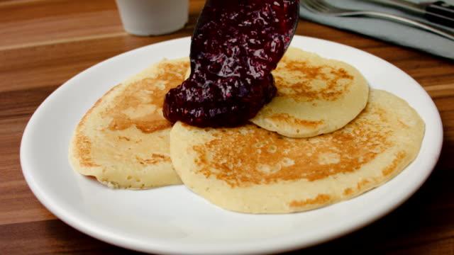 Jam superimposed spoon on pancakes video