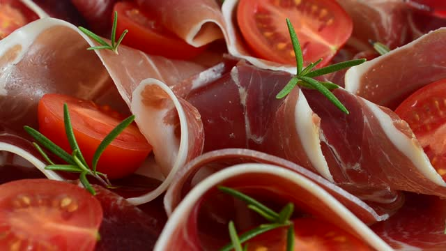 Jamon with tomatoes and rosemary. video