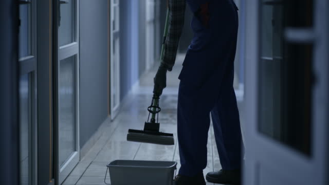 Janitor cleaning a corridor video