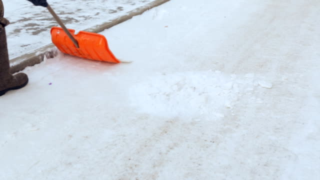 Janitor cleaning the yard of snow video