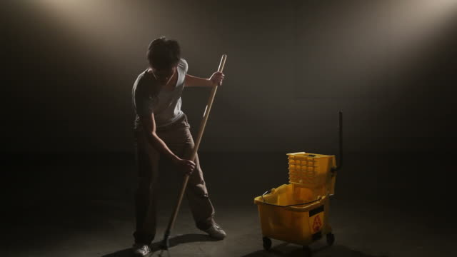 Janitor mopping and dancing video