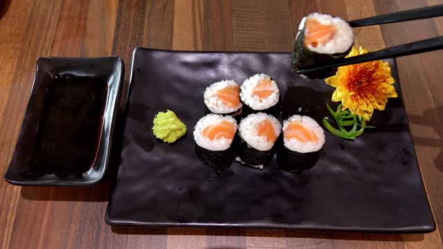 Japan girl eating sushi roll Japan girl eating sushi roll sashimi stock videos & royalty-free footage
