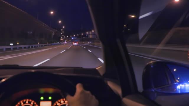 japan logistics network, highway at night - wagon kolejowy filmów i materiałów b-roll