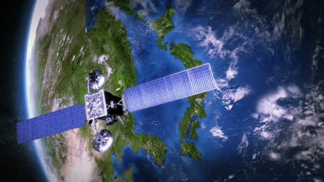 stockvideo's en b-roll-footage met japan. telecommunication satellite orbiting earth. - image