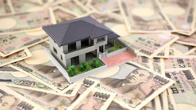 da 10000 yen giapponese e house - conto corrente video stock e b–roll