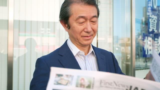 Japanese Businessman Reading Newspaper video